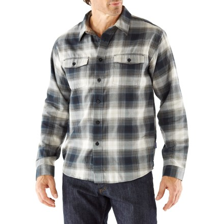 The Patagonia Buckshot flannel shirt delivers classic style and a whole lot of comfort. Midweight organic cotton/polyester flannel is soft and comfortable. Organic cotton is grown without the use of toxic pesticides. 2 chest pockets with button-flap closures secure everyday essentials. Shirttail hem stays tucked in. Slim fit minimizes bulkiness. - $79.00