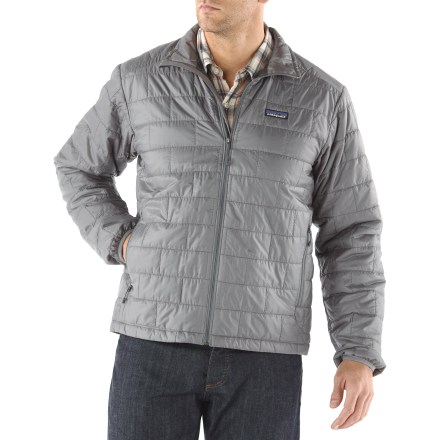The men's Patagonia Nano Puff jacket is wind- and water-resistant and highly compressible. This warm jacket can be worn as a mid layer or as outerwear in cold climates. It's weather resistant enough to wear as an insulated shell in a wet snowstorm, trim enough to pull on for chilly rock pitches and warm enough for light belay parka duty. Versatile PrimaLoft(R) One polyester insulation provides excellent warmth and compressibility. Wind-blocking, moisture-shedding, recycled ripstop polyester shell glides effortlessly whether worn as a middle or outer layer. Unique quilt pattern holds insulation in place promoting durability and longevity; Deluge(TM) Durable Water Repellent finish repels moisture. Full-length zipper with internal draft flap, elasticized cuffs and drawcord hem seal out wind and trap warmth. Patagonica Nano Puff packs down to practically nothing and stuffs into the internal zip chest pocket (includes a caraginer clip-in loop); 2 zip handwarmer pockets. Regular fit eases layering. 100% recyclable through Patagonia's Common Threads Recycling Program-simply return your worn-out item to Patagonia. - $138.93