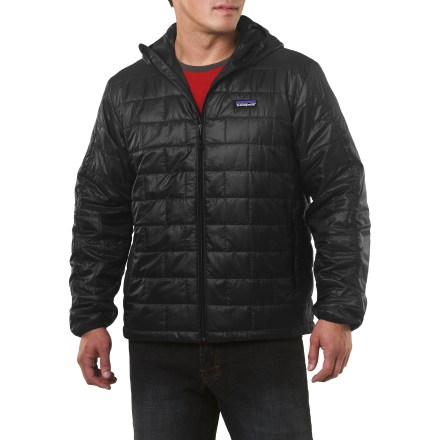The men's Patagonia Nano Puff hooded jacket is wind- and water-resistant and highly compressible. Very warm for its weight, this jacket can be worn as insulation or as outerwear in cold climates. It's weather resistant enough to wear as an insulated shell in a wet snowstorm, trim enough to pull on for chilly rock pitches and warm enough for light belay parka duty. Versatile PrimaLoft(R) One polyester insulation provides excellent warmth and compressibility. Wind-blocking, moisture-shedding, recycled ripstop polyester shell glides effortlessly whether worn as a middle or outer layer. Unique quilt pattern holds insulation in place promoting durability and longevity; Deluge(TM) Durable Water Repellent finish repels moisture. Under-the-helmet hood construction keeps things light and simple. Full-length zipper with internal draft flap, elasticized cuffs and dual-drawcord hem seal out wind and trap warmth. Patagonia Nano Puff Hoodie packs down to practically nothing and stuffs into the internal zip chest pocket (includes a carabiner clip-in loop); 2 zip handwarmer pockets. Regular fit eases layering. 100% recyclable through Patagonia's Common Threads Recycling Program-simply return your worn-out item to Patagonia. - $173.93