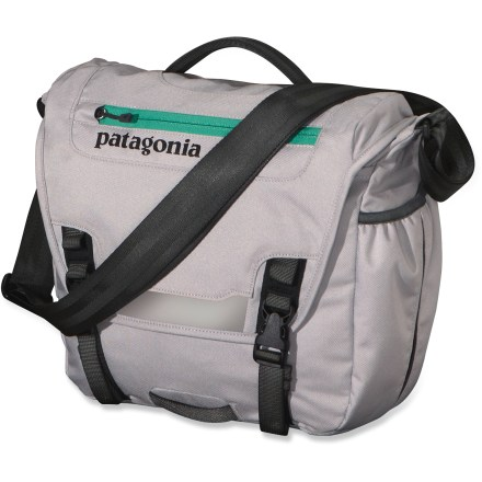 Entertainment The Patagonia MiniMass messenger bag is a downsize courier bag that holds a day's essentials but still allows you to stay light and move freely. It's sized to hold the basics: lunch, phone, keys, a book or 2, and a stuffable rain shell. Main flap opens to largest compartment which houses 1 drop pocket, 1 mesh pocket, 1 padded electronics pocket, 3 pen slots and a discrete and secure zippered pocket. Interior drop pocket secures with hook and loop tab for quick access to boarding passes, magazines or newspapers. Large weather-shedding front flap sports a zip pocket, reflective panel and a mount for a bike light (sold separately); includes a side-mounted exterior water bottle pocket. Pocket on flap has a moisture-shedding reverse coil zipper. Patagonia MiniMass features a fully adjustable, no-slip shoulder strap and top-side carry handle. Made of tough, lightweight 600-denier recycled polyester with a slick 200-denier polyester liner; both are coated with polyurethane. Fabric is treated with a Durable Water Repellent finish to repel moisture and stains. - $50.93