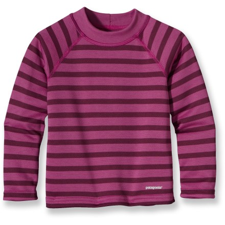 Ski The Patagonia Baby Capilene 3 Midweight shirt for toddler girls is highly breathable and fast drying. It's ideal for high-energy activities in a wide range of temperatures. Patagonia has reinvented its Capilene(R) performance base layers, making them now from recycled and recyclable synthetic fiber. Gladiodor(R) natural odor control employs benign amino acids to help keep funky scents at bay; plus, it's nonpolluting, safe and durable. Yoke, raglan sleeves and single-piece shoulder panel merge out of the way for increased comfort under a backpack or ski bibs. Patagonia Baby Capilene 3 Midweight top features flatlock seams that are non-bulky and supple. - $29.00