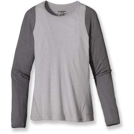 The breathable, quick-drying women's Patagonia Capilene(R) 2 long-sleeve crew top is ideally suited as a first layer for high-endurance activities in a wide range of temperatures. Patagonia has reinvented its Capilene performance base layers, making them now from recycled and recyclable synthetic fiber. Lightweight, open-knit fabric invites airflow, dries quickly and works well when layering; fabric features high recycled content. Gladiodor(R) natural odor control employs benign amino acids to help keep funky scents at bay; plus, it's nonpolluting, safe and durable. Raglan sleeves eliminate shoulder seams, enhancing range of motion and comfort under pack straps. Flat rib-knit underarm and side panels are extra soft for chafe-free comfort where arms are most active next to fabric. Flatseam construction is soft and non-chafing next to skin. Contoured, slim fit minimizes bulk to create an easy-layering garment that won't restrict your movement. Hem length appropriate when left untucked. 100% recyclable through Patagonia's Common Threads Recycling Program-simply return your worn out item to Patagonia. - $10.83