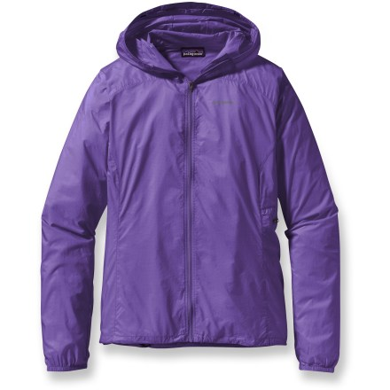 The ultrapackable Patagonia Houdini women's full-zip jacket sheds fickle weather, and disappears into its self-storage pocket like magic. Tough, triple-ripstop nylon softshell features a Durable Water Repellent to shed moisture. Zippered side pocket converts into a stuff sack with a carabiner clip loop. Low-volume hood cinches around face, adjusting with 1 tug. Elastic cuffs and drawcord hem keep cold air out. Houdini jacket may be worn over base layers and light mid layers. Closeout. - $47.83