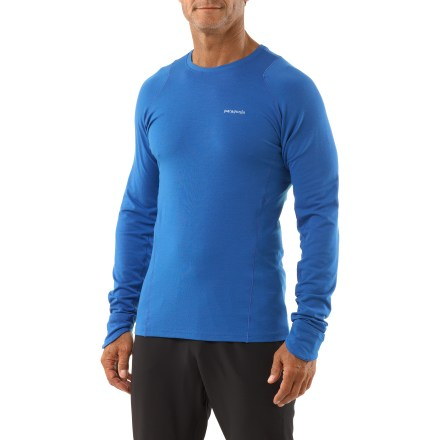 Fitness The Patagonia Thermal Flyer shirt will keep you running on cold days with a soft merino wool blend designed to last. Merino wool naturally insulates, wicks away moisture and resists odors; blended recycled polyester in fabric boosts durability. A touch of spandex adds stretch for a fit that won't feel constrictive. Minimal seams are designed for exceptional next-to-skin softness. Shaped, fold-over cuffs create makeshift mittens to keep your hands toasty. Patagonia Thermal Flyer shirt features a slim fit. - $82.93