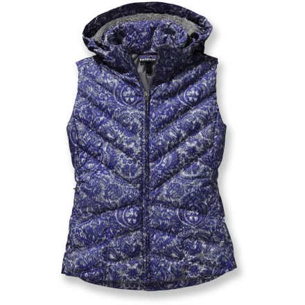 After any frigid activity, rewarm your core with the Patagonia Down With It vest. It's made with a recycled polyester shell and goose down insulation, and the hood removes conveniently. All-recycled polyester shell is treated with a Durable Waterproof Repellent finish to shed moisture. 600-fill-power premium European goose-down insulation provides serious warmth, and the front zipper allows ventilation. Removable, adjustable hood is lined with luscious deep-pile fleece. Diagonal chevron quilting lends a contoured fit; non-quilted side panels provide a sleek silhouette. Zippered on-seam handwarmer pockets and an internal zippered security pocket. Patagonia Down With It vest has a slim fit. - $61.83
