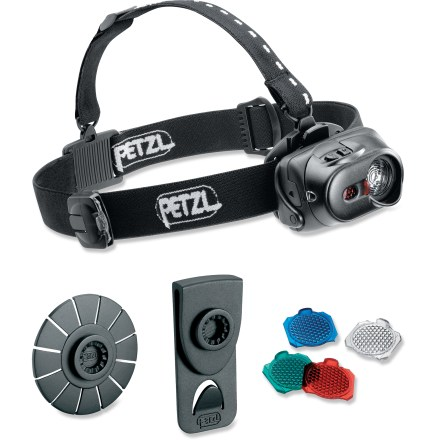 Camp and Hike Based on the much-lauded Tikka XP, the Petzl Tactikka XP Adapt LED headlamp goes a couple better, with filters for nighttime visibility and new mounting options! Red, green and blue filters aid your ability to see in the dark without experiencing night blindness caused by rush of bright light against the eye. Cover mechanism lets you slide the filter of your choice over the powerful LED as needed; filters easily swap out in moments. Plus, for added versatility, the lamp can be removed from its headstrap and mounted to clip for attaching to a belt, cap brim or pack strap. Set also comes with a second, self-adhesive clip for attaching lamp to firm, smooth surfaces, such as the front of a climbing helmet. LED outputs 40 lumens and throws light up to 35m on high and 18m on low. Super-powerful Boost mode throws light up to 50m when you need extra visibility; Boost mode stays active for a maximum of 20 sec. to prevent overheating of the LED circuitry. Push-button switch easily changes between 3 brightness settings and a strobe mode so you can choose the appropriate light level for the task at hand. Slide-away diffuser lens cover changes beam shape from spot light to area light for different conditions. Powered by 3 AAA batteries, headlamp can provide up to 120 hrs. of light on low setting and 60 hrs. on high. 3-color battery-charge indicator provides visual status of remaining battery life, eliminating guesswork. Adjustable elastic band comfortably fits a variety of head sizes; tilting ratchet head adjusts light where you need it without crooking your neck. Petzl Tactikka XP Adapt LED headlamp is designed with IPX4 water resistance for reliability in inclement weather. - $48.93
