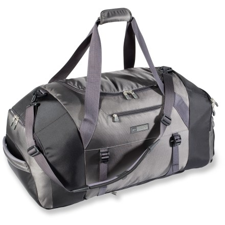 Camp and Hike The large-volume REI Cargo Adventure duffel is designed for active travelers who need plenty of space for clothes, gear and footwear. Large U-shaped zippered flap provides access to the main compartment; underside of flap features a mesh pocket with key tether. Pockets on each end offer storage for shoes, boots and dirty clothes. Adjustable backpack-style shoulder straps located on the bottom panel ease carrying; straps zip away when not in use. Duffel-style handles and removable, adjustable shoulder strap with fixed pad provide comfort and versatility while hauling the bag. Padded grab-handles at each end allow quick two-person grabbing and hucking from ground to car, train or boat. Lockable zipper sliders let you secure your possessions; locks sold separately. Small front-panel pocket holds travel essentials; front straps with buckles secure a yoga mat or jacket. Abrasion-resistant 420-denier nylon fabric withstands the rigors of travel. - $78.93