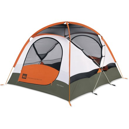 Camp and Hike With a compact, geodesic dome design that makes it strong and storm-worthy, the REI Base Camp 6 is easy to set up and roomy enough for your group of 6 and your gear. Color coding makes the tent quick to set up with a combination of clips, sleeves and 4 strong aluminum poles that give the tent flexible stability. Large front and rear doors offer easy access and tuck cleanly away into interior pockets. Generous mesh windows in walls, ceiling and doors provide excellent ventilation; 2 fly ceiling vents help reduce condensation and can be accessed from inside the tent. Front and rear vestibules provide ample covered space to store gear; front vestibule's window lets you see the view and enjoy the light. Mesh gear attic and multiple interior pockets keep your tent organized; hang loops are located throughout the tent. Bound, cut-in floor and UV-resistant, full coverage polyester rainfly will not stretch or expand when wet, ensuring a consistently taut pitch. Convenient backpack-style carry bag organizes tent, fly and poles with extra space for footprint; footprint sold separately. The REI Base Camp 6 tent comes with 12 stakes, 4 guylines with tighteners, pole repair tube and gear attic. - $419.00