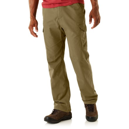 The 32 in. inseam REI Thetford Cargo pants have pockets for everything you'll need to enjoy a day of urban exploring. Cotton/nylon midweight blend fabric stands up to regular wear yet has a soft hand for great comfort; fabric wicks moisture and dries fast. With a UPF 50+ rating, fabric provides excellent protection against harmful ultraviolet rays. Side cargo pockets provide ample space for your urban essentials; 2 hand pockets and 2 rear pockets provide additional storage. Hand pockets are designed to keep items from sliding out when you sit. Drawstrings at the waist and cuffs help you fine-tune the fit. Center gusset eases movement. REI Thetford Cargo pants have a relaxed that fit allows for comfort and freedom of movement. - $44.93