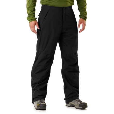 Camp and Hike Offering waterproof, breathable protection at a great price, the Alpine Lakes rain pants in a 32 in. inseam are perfect for backpacking and other active pursuits in wet weather. Seam-sealed REI Elements(R) nylon shell provides moderate stretch and blocks wind to 60 mph. Lining combines nylon taffeta, which slides easily over layers, with highly breathable, moisture-wicking polyester mesh in key areas. Back elastic waist and side rip-and-stick tabs adjust the fit for comfort. Full-length side zippers offer ventilation control and easy removal over footwear; scuff guards protect inner ankle fabric from abrasion. Articulated knees improve ease of movement, and are reinforced for durability. 2 zippered front pockets and 1 zippered back pocket. Fabric in the Alpine Lakes rain pants is designed to resist snagging and pilling, and it dries in under 4 hours. - $99.50