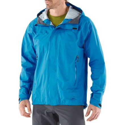 Camp and Hike The men's REI Kimtah jacket is perfect for spring and summer backpacking adventures. It's made with eVent(R) fabric and offers protection for activities where windy, wet weather is a concern. eVent fabric has a unique membrane structure that allows sweat vapor to quickly escape to the outside of the fabric. No matter how hard you work, overheating is unlikely due to this Direct Venting(TM) technology. And because you remain dry on the inside, the likelihood of an uncomfortable, post-exercise chill is eliminated. eVent technology works so efficiently, no pit zippers are needed; all seams are sealed for complete waterproof protection. Windproof to 60 mph. Fully adjustable brimmed hood features easy-to-use ripcord-style cinches. Includes a full-length, water-resistant front zipper with windflap and chin guard. Features adjustable hem drawcord and snow-resistant rip-and-stick cuff tabs; angled sleeves extend coverage over top of hands. Hand pockets are placed for easy access with a pack on; mesh lining and long zippers boost breathability. Flash pocket underneath center front placket adds stow space and features an earphone cord port. REI Kimtah jacket has an active fit that allows a full range of motion and enhances performance. - $239.00