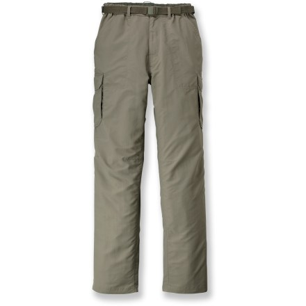 Camp and Hike Whether you're on a dusty trail in the mountains or boarding a plane for an overseas journey, the lightweight REI Sahara Cargo pants offer comfort and convenience to keep you happy. Lightweight nylon fabric dries quickly and resists pilling, and is easy to pack away in a backpack. With a UPF 50+ rating, fabric provides excellent protection against harmful ultraviolet rays. Fabric is treated with a Durable Water Repellent finish to repel moisture and stains. Pleated cargo pockets with rip-and-stick flap closures offer ample space for trail and travel items; a zippered pocket on the left side secures essentials. 2 front hand pockets (1 has an inner coin pocket), 1 rear zippered pocket and 1 rear rip-and-stick pocket provide additional storage. Gusseted crotch facilitates freedom of movement for increased comfort. Included webbing belt can be completely removed and worn with other pants. Elastic waist helps secure the fit; waist features a snap and a zippered fly. The REI Sahara Cargo pants have a relaxed fit. - $32.69