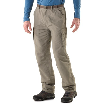 Camp and Hike Whether you're on a dusty trail in the mountains or boarding a plane for an overseas journey, the lightweight REI Sahara Cargo pants offer the fit and features to keep you comfortable. Lightweight nylon fabric dries quickly and resists pilling, and is easy to pack away in a backpack. With a UPF 50+ rating, fabric provides excellent protection against harmful ultraviolet rays. Fabric is treated with a Durable Water Repellent finish to repel moisture and stains. Pleated cargo pockets with rip-and-stick flap closures offer ample space for trail and travel items; a zippered pocket on the left side secures essentials. 2 front hand pockets (1 has an inner coin pocket), 1 rear zippered pocket and 1 rear rip-and-stick pocket provide additional storage. Gusseted crotch facilitates freedom of movement for increased comfort. Included webbing belt can be completely removed and worn with other pants. Elastic waist helps secure the fit; waist features a snap and a zippered fly. The REI Sahara Cargo pants have a relaxed fit. - $37.93