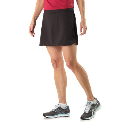 The quick-drying REI Fleet skort offers the looks of a skirt with the workout coverage of shorts. Quick-drying and lightweight fabric delivers 4-way stretch and an extremely soft feel against skin; stretch-mesh side panels increase breathability. Stretchy liner shorts wick moisture away from body to keep you comfortable. Outer fabric of the REI Fleet skort protects legs via a UPF rating of 50+. Elastic waistband with drawcord fine-tunes the fit. Internal liner shorts feature an envelope pocket to store small extras. Outer skirt measures 14.5 in. The REI Fleet skort offers an active fit that supplies a full range of motion. - $22.83