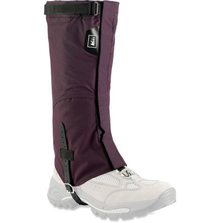 Camp and Hike Ideal for travel in spring conditions or when bushwhacking through wet brush, the full-length REI Trail gaiters keep your boots snow- and debris-free. Durable nylon uppers with ripstop-lined Cordura(R) nylon lowers stand up to hard use; uppers and lowers are water resistant. 15 in. length provides excellent coverage when tromping through snow and blasting through brush. Rip-and-stick front closures allow quick, easy on/off without fumbling with zippers. Changing the amount of overlap on the front closures adjusts the bottom circumference to fit gaiters over different boot styles. Adjust and set snugness with rip-and-stick tabs at the tops of the gaiters. Laminated nylon instep straps and stay-put lace hooks complete a secure fit around your boots. - $26.93