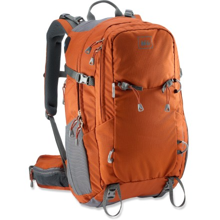 Camp and Hike The REI Lookout 40 men's pack provides plenty of pockets for organizing a full day's worth of gear. A contoured fit helps keep you comfy over miles of trails. Made with recycled PET polyester fabric, each pack helps keep plastic bottles out of landfills. Post-consumer recycled PET polyester is tough enough to endure the daily grind. High-density polyethylene framesheet and a single aluminum stay support heavy loads and protect your back from bulky or pointy items. Sculpted foam back panel is designed to improve body contact comfort, with channels for air circulation to keep your back cool and dry. Contoured, padded shoulder straps and waistbelt wrap around to offer comfortable support under pack load; buckle on sternum strap doubles as a safety whistle. Wide panel opening to main compartment gives you easy access to contents. Internal sleeve accommodates a hydration reservoir of your choice (sold separately). Front zip compartment has pockets for stashing and organizing essentials, such as money, ID, multi-tool and headlamp. Top stash pocket has room for items, such as sunglasses or MP3 player. Zippered pockets on waistbelt provides storage for often-accessed essentials. Side mesh pockets create convenient storage for on-the-go access to water bottle, sunscreen, snacks or small electronics. Front-panel lash points and bottom compression straps let you strap on bulky gear, such as snowshoes and a sleeping pad. Side compression straps let you cinch down loads for jostle-free carrying. Twin loops and corresponding removable retainers let you lash on an ice axe or trekking poles. - $68.93