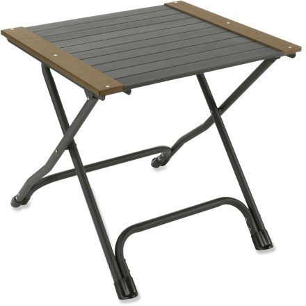Camp and Hike Take the REI Comfort Deluxe table along on a car-camping trip or set it up on the back deck. 24 in. table height is convenient for use as a side table or casual outdoor dining table. Powder-coated aluminum tubing frame is lightweight, strong and rust resistant. Tabletop slats-constructed of aluminum and wood/plastic composite-stand up to bad weather. REI Comfort Deluxe table folds flat for easy storage and transport. - $38.93
