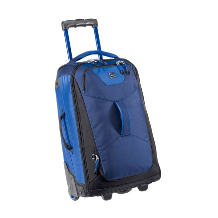 Entertainment The REI Tech Beast 22 is built for the short haul and keeps you organized and your travel simplified. It fits in most overhead bins and is suited for adventures that require tough luggage. High performance components, tough fabric and thoughtful design elements are blended into a small profile and targeted for space-constrained travelers. Rugged telescopic pull handle locks in up/down position; soft-touch handle grip ensures comfort and control through the twists and turns of travel. Rugged wheels and housings provide durability and smooth wheeling for the long haul. Interior frame provides structure and upright stability for transport ease. Full zippered panel-opening main compartment offers easy access. Lower front pocket has an internal expansion zipper to provide extra storage for laundry bag or shoes/boot storage. Fully lined interior features 2 compression straps and 2 side zippered mesh pockets for organization. Slip-out Travel Organizer holds essentials and has a clear panel for storing travel bottles; tethered and easy to remove for airport security screenings. Zippered front pocket allows quick stashing of last-minute items such as toothbrush or journal. Zippered pocket on back panel is sized for magazines and travel documents. Top and side grab handles make handling a breeze. REI Tech Beast is constructed of abrasion-, moisture- and tear-resistant ballistic nylon for exceptional durability. - $118.93