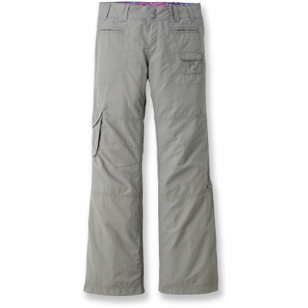 Our adaptable REI Sahara Roll-Up pants for girls provide comfort, style, and sun protection from the playground to the trail. Abrasion-resistant, peached nylon fabric is lightweight and dries fast for worry-free, all-day comfort. Snap tabs at knees convert REI Roll-Up pants to capris; articulated knees follow natural movement. UPF 30 rated fabric offers protection from damaging UV rays. Pants feature 2 hand pockets, 2 rear pockets, 1 coin pocket and 1 cargo pocket with rip-and-stick closure. Contoured cut with internal-button elastic waistband personalizes the fit. - $26.93