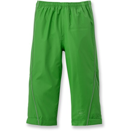 The PVC-free REI Rainspout rain pants will help keep your little one dry and comfortable during his puddle-jumping adventures. Sturdy, lightweight nylon sports a Durable Water Repellent coating; seams are sealed to block out rain and wind. Elastic waist with drawcord adjusts easily for a secure fit. Adjustable rip-and-stick cuff tabs help seal out the rain. Reflective accents enhance visibility in low light. - $8.83