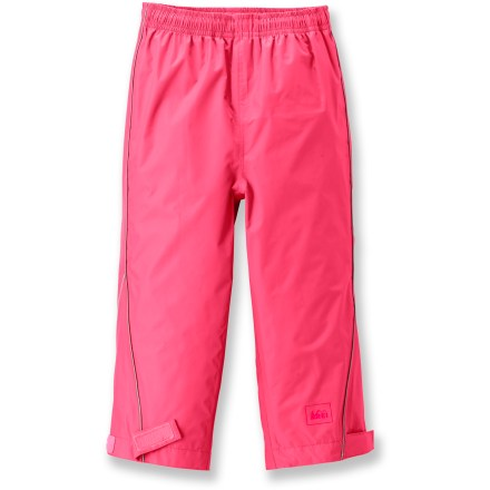 The water-resistant and breathable REI Rainspout rain pants help keep little girls dry, comfortable and ready for playing in the rain or splashing in puddles. PVC-free rain pants feature a 2-layer water-resistant/breathable coating; they are also wind resistant up to 60 mph. Adjustable ankle cuffs and elastic waist with drawcord and cord lock provide a perfect fit. Reflective accents improve visibility in low light. - $8.83