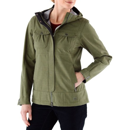 The winter-worthy REI Cress Creek soft-shell jacket provides weather protection plus warmth. Its sharp urban design wears well both in town and on the slopes. Highly water-resistant polyester shell has a Durable Water Resistant finish and blocks wind to 60 mph; tricot lining offers light insulation. 2-way front zipper eases sitting and provides venting options; shaped placket has snap closures. Hood adjusts for optimal peripheral vision. Drawcord hem and cuff zippers with snap tabs keep cold out. Straddle top-stitching seam detail adds attractive style. Handwarmer pockets feature patrtially exposed Metaluxe zippers; snap-flap chest pockets with cord port exit on 1 side. Inner stash pocket. REI Cress Creek soft-shell jacket has a classic, easy-wearing fit. - $110.93