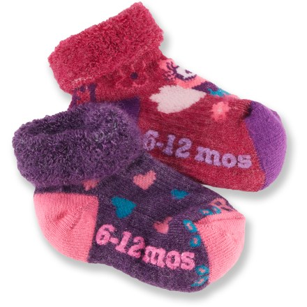 The REI Heart/Owl bootie socks will help keep baby girls' toes toasty warm with a soft blend of baby alpaca, nylon and organic cotton. Nylon and viscose from bamboo add durability; spandex offers stretch and shape retention. Cushioned heels and toes add comfort and protection from wear; non-skid bottoms offer feet traction from the first step. Soft, roll-down cuffs are comfortable against tender skin. *Discount will be applied when you check out. Offer not valid for sale-price items ending in $._3 or $._9. Please note: a package of 2 pairs counts as 1 pair of socks for the 10% volume discount. - $4.83