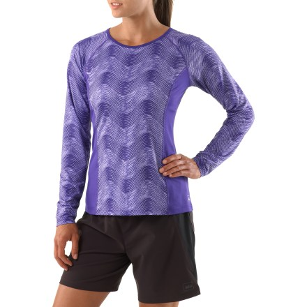 Fitness Offering a feminine fit and extra coverage to help keep arms warm, the REI Fleet long-sleeve T-shirt is a top performer for aerobic activities. Moisture-wicking fabric dries fast so you won't feel chilled when a breeze kicks up, and mesh inserts along sides and on sleeves increase ventilation. Fabric provides UPF 50+ protection from harmful solar rays. Mesh fabric along upper back enhances ventilation. Reflective details increase visibility in low light. Flatlock seams reduce chafing. The REI Fleet T-shirt offers an active fit that moves with you during acrtivity. - $24.93