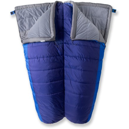 Camp and Hike The REI Siesta double sleeping bag brings the creature comforts of home to the campsite, yurt or cabin. This roomy bag provides warmth and comfort for 2 happy campers. Generous barrel shape provides ample interior volume, making it ideal for those who prefer a roomy fit. Hollow-core insulation delivers a balance of compressibility, warmth and durability; bag continues to insulate when wet and dries quickly. Ripstop nylon shell is abrasion- and tear-resistant for years of use. Shell fabric is treated with a Durable Water Repellent finish to repel moisture and stains. Main body features a smooth polyester taffeta lining that breathes for comfort and feels great against skin. Brushed polyester knit lining panels near the head and face offer the softness of your favorite T-shirt with the moisture-wicking properties of a high-tech fabric. Layered offset quilt construction eliminates cold spots. For sharing the load, bag zips apart to become 2 bags; bags can be used separately or connected to another Siesta sleeping bag/sheet (sold separately) for customized comfort. Full side and bottom zipper access; bags can be completely unzipped and opened up for use as comforters. Zippers are backed by wide, antisnag binding tape. REI Siesta +35degF sleeping bag includes a cotton storage bag. - $114.93
