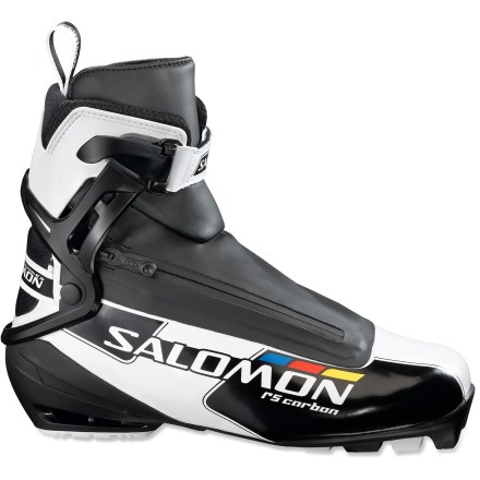 Ski The race-ready Salomon RS Carbon skate boots offer high-performance features and a comfortable fit so you can enjoy day after day of fast-paced skiing. Light and responsive SNS(R) Pilot(R)2 Carbon Pro outsoles feature 2 connection points with SNS Pilot skate bindings (sold separately) for excellent control while skiing. Front connection points are placed 10mm back from the front of the boots for a natural kick and good energy transfer. Supportive Energyzer cuffs enhance lateral support and help position your lower legs properly before and after kick. Proper leg positioning allows your lower legs and feet to relax, reducing leg and foot fatigue while also lifting the tips of the skis for less drag and quick ski return. Carbon 3D boot chassis provides high torsional rigidity while keeping the boots light; torsionally rigid boots off good support and control. Boot liners feature comfort foam, thermal-formable foam and Lycradeg spandex for a great feel; thermal-formable foam molds to the shape of your feet for a custom fit. Salomon Quicklace Kevlar(R) laces pull snug with a single tug; lace covers with diagonal zippers keep snow out. Rear straps can be adjusted for better heel hold. RS Carbon boots feature a 102mm forefoot width and medium volume for great foothold, comfort and fit; boots have a slightly more generous fit than other race boots. Salomon RS Carbon skate boots are compatible with SNS Pilot bindings. - $179.93