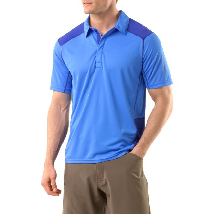 Camp and Hike Comfort is key when you're on the trail, but style also counts. The lightweight Salomon Cosmic Polo shirt keeps you feeling great and looking good. Lightweight polyester mesh fabric on the front allows lots of airflow to keep you cool when you're working hard on the trail. Fabric wicks moisture and dries quickly. Front placket closes with snaps. - $37.93