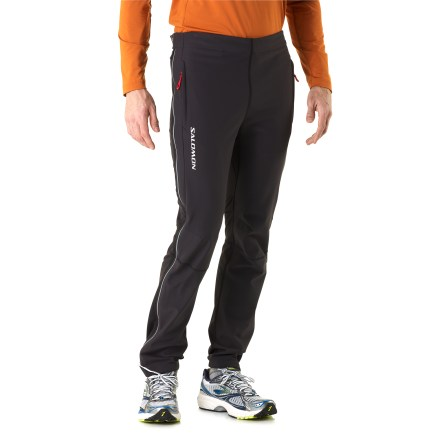 Ski Don't miss a step in your stride in the Salomon Momentum II full-zip soft-shell pants, which boast a wind-blocking front and breathable, wicking back, plus full-zip ease, to ensure fast-paced comfort. Front of legs feature a highly wind-resistant and breathable fabric, keeping you comfortable during arduous aerobic activities. Backs of legs use a stretch-knit fabric that moves with you, wicks moisture and dries quickly. Full-length side zippers with snap cuffs allow easy on/off without having to remove your boots. Gusseted crotch facilitates freedom of movement for increased comfort. Reflective detailing on front and back increases visibility. 2 zippered pockets store exercise gel, cards or keys. Drawcord waistband on the Momentum II soft-shell full-zip pants supplies a personalized fit. - $111.93