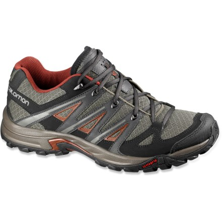 Camp and Hike Light, cushioned and ready for the trail, these Salomon Eskape Aero hiking shoes offer great breathability and comfort for light hiking and everyday adventures. Highly breathable and abrasion-resistant nylon mesh uppers feature thermoplastic urethan overlays that wrap and secure insteps for a precise fit; toe caps provide protection. Endofit internal fit sleeves hug and wrap forefeet to deliver seamless comfort along with excellent feel to keep you connected with the terrain. Polyester mesh linings quickly wick moisture away from feet. Injected EVA midsoles deliver light weight and excellent cushioning for all-day wear. Advanced Chassis design helps maximize efficiency and propulsion to help keep you moving along swiftly. Salomon Eskape Aero hiking shoes have aggressive, nonmarking Contagrip(R) rubber outsoles to deliver solid footing on trails. - $76.93