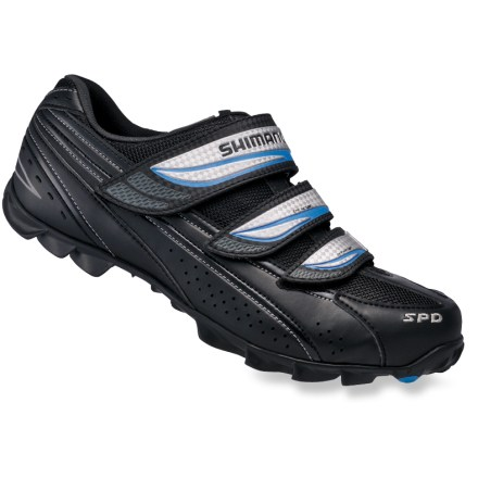 MTB Shimano WM51 women's mountain bike shoes offer rigid pedal support and lightweight walking traction for hill climbs, fast lines and rolling hills. - $24.83