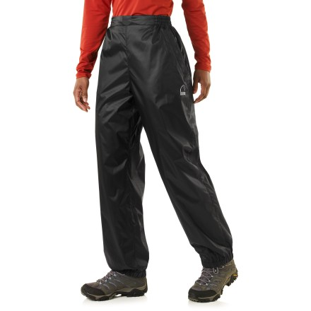 The women's Microlight pants from Sierra Designs provide wind protection and water resistance on or off the trail-and they pack up small in their own stuff sack. Polyester taffeta fabric with a polyurethane coating offers ample water resistance and wind blocking at a great value. Elastic drawcord waist personalizes the fit; leg hems are open. Seams are not sealed, but the pants offer water resistance in light rain for a short period of time. - $16.83