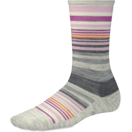 Stripes beget smiles, and the SmartWool Jovian Stripe socks will supply plenty of them, thanks to cozy merino wool, cushioned construction and, of course, the fun stripes. Made from soft merino wool blended with nylon, these socks wick moisture away from your feet, keeping them dry and cool in the summer and warm in the winter. Spandex helps socks stretch and deliver all-day comfort; supportive arch braces add stability and help keep socks in place. WOW (wool on wool) technology increases wool content in high impact areas, improving durability and overall comfort. Cushioned construction delivers comfort for all-day wear; buried toe closures improve comfort by reducing chafing and chance of blisters. SmartWool socks are guaranteed not to itch and can be repeatedly washed and dried without shrinking. Closeout. - $13.93