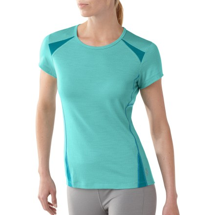 The SmartWool Cortina Tech T-shirt is loaded with thoughtful features to deliver complete comfort and freedom of movement, so you can stay out longer and enjoy your activities more. Made from soft merino wool blended with polyester to wick moisture away from your body, keeping you cool and dry; shoulder and side panel fabric increases durability. Fabric provides UPF 25 sun protection, shielding skin from harmful ultraviolet rays. Specialized eyelet knitting enhances breathability and ventilation to keep core cool. Flatlock seams maximize motion and minimize abrasion. Cortina Tech T-shirt has 1 zippered pocket at center back with grommet for media cord routing. Back hem is dropped slightly for full coverage. Machine washable in cold water; reshape and dry flat. Closeout. - $26.73