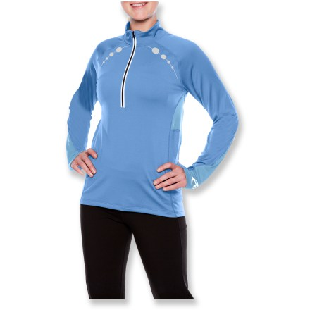 The SportHill Ultimate Visibility zip top offers plenty of reflective hits to keep you visible at dusk or dawn. 4-way stretch polyester/spandex fabric front panels offer great wind protection and excellent moisture management; dries quickly for cold-weather comfort. Polyester/spandex panels on sides and back supply exceptional breathability and moisture-moving properties for increased comfort during hard sessions. Deep 12 in. front zipper with internal windflap and zipper garage lets you control ventilation. Thumbholes let you secure the sleeves over hands and wrists for warmth. Raglan sleeves eliminate shoulder seams for increased range of motion and comfort. Reflective detailing and high-visibility color panels increase your visibility in low light. Slim, athletic cut of the SportHill Ultimate Visibility zip top adds support, wicks moisture and keeps you warm. Special buy. - $23.73