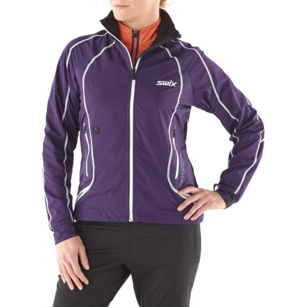 Ski Don't let cold weather slow your pace. The Swix Star XC women's jacket is designed to keep you comfortable during fast-paced activities through the cooler months. Polyester fabric used on front of jacket and tops of arms is wind- and water-resistant and highly breathable; laser-cut vents under arms and on upper back increase ventilation. Durable Water Repellent finish causes water to bead up and roll off, fending off light rain showers and snow. Polyester and spandex panels on back, under arms and elbows and along sides offer excellent freedom of movement and breathability. Droptail hem is long in back, offering increased coverage for active sports. Drawcord hem, drawcord stretch collar, extended stretch cuffs and windflap behind front zipper all contribute to keeping warmth in and cold out. Zippered hand pockets offer easy access to essentials such as energy gels and lip balm; zippered media pocket has a cable port for easy access to your tunes. The Swix Star XC women's jacket includes reflective detailing that increases your visibility in low light. - $79.83