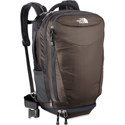 "Camp and Hike The North Face Overhaul 40 daypack is a heavy-duty hauler for those on the go through airports, across trails and into urban canyons. Main compartment features an organizer panel for pens, PDAs and cards; a large mesh pocket stashes electronic accessories; a universal sleeve stores documents. Separate, dedicated laptop compartment has a water-resistant zipper and accommodates laptops with 17 in. screens. Secondary compartment is perfect for clothing and other travel and work essentials; compartment features a large expansion panel and internal organization. Zippered, externally accessed ""laundry"" compartment stows dirty gear separately from the clean goods. Front zippered pocket and dual stretch water bottle pockets allow quick access to gear and hydration. Padded air-mesh shoulder straps with sternum strap and padded back panel combine with a winged, padded waistbelt to comfortably distribute the load. Suspension system can be easily tucked away behind back panel for simplified transport on airlines. Padded top and side carry handles supply additional carry options. External slide-through sleeve goes over the handle of your wheeled luggage for convenient transportation through the terminal. The North Face Overhaul 40 daypack is constructed of abrasion-, moisture- and tear-resistant nylon for exceptional durability. - $159.00"