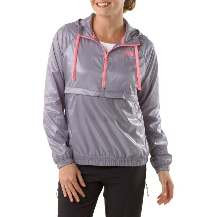 The North Face J-LU Anorak Hoodie jacket glamorizes your mild-weather wear. Polyester fabric features a shiny metallic finish for style; Durable Water Repellent finish sheds light moisture. Contrasting quarter-zip front offers quick ventilation. Zippered front pocket features a flap closure. Elastic cuffs and hem round out features. Closeout. - $35.83