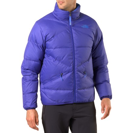 The North Face Reversible Down jacket is a great choice for cold-weather adventures or around town wear. This jacket will keep you warm as the temperature drops. Reversible design lets you choose between 2 different colors. Durable recycled polyester/polyester shell on each side stands up to everyday wear. Insulated with quality 550-fill-power goose down for warmth, light weight and compressibility. 1 exterior features a baffled design while the reverse is a smooth finish. No matter which side you wear facing out, The North Face Reversible Down jacket provides 2 zippered pockets for keeping hands warm. Elastic cuffs and hem seal out the cold. - $94.83