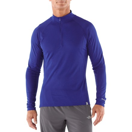 Featuring a comfort-enhancing front zipper, The North Face Light zip neck helps keep you comfortable during adventures in cool weather. Moisture-wicking polyester and polyolefin fabric features FlashDry(TM) microparticles embedded in the fabric to dramatically improve dry time and breathability. Made of crushed coconut husks and crushed volcanic rock, the FlashDry fabric additive leads to faster dry times and will not wash out. You'll move without restriction thanks to the stretchy fabric and flat seams, which are designed to enhance motion. Half-length zipper ventilates instantly. The North Face Light crew neck offers a relaxed fit that skims the body. - $23.83