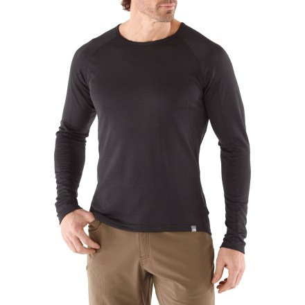 When it's cold and you're ready for outdoor adventures, use The North Face Warm Crew Neck top for men to keep you comfortable. - $24.83