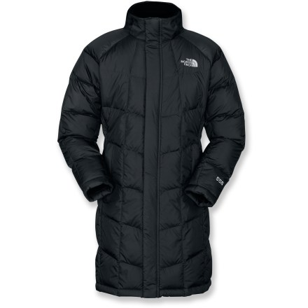 The North Face Metropolis Down jacket for girls ofers a down-filled, knee-length blanket of stylish warmth. Nylon shell fabric is treated with a Durable Water Repellant finish and filled with 550-fill-power goose down for unsurpassed warmth and compressibility. Removable, insulated hood adds protection when the mercury drops. Brushed inner collar, chin guard and cuffs wick away moisture and are soft against skin. Zipper and snap-front closure seal in warmth. The North Face Metropolis Down jacket features zippered hand pockets and an interior security pocket. - $160.93