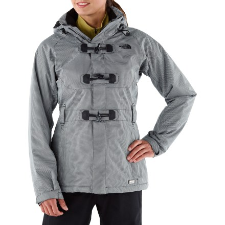 Snowboard The North Face Ginger Delux insulated women's jacket protects you against the biting elements of winter. A windproof, waterproof breathable shell and insulation keep you wrapped in warmth. Breathable, waterproof 2-layer laminated HyVent(R) twill shell fabric keeps you dry in snowy, wet conditions. Fully taped seams create the ultimate seal against wind and snow. Jacket uses Heatseeker(TM) polyfiber insulation to keep you warm without inhibiting mobility (100g in body, 80g in sleeves/hood). Quilted satin and embossed taffeta lining helps wick away moisture, dries fast and eases layering. Adjustable hood protects you in inclement weather, and detaches when you don't need it. Zippered underarm vents let you quickly control core temperature, expelling excess body heat as need during high activity. Magnetic center front closure and oversize toggle buttons allow easy opening/closing while wearing gloves. Zippered handwarmer pockets offer a cozy spot to warm your digits. Internal storage options include a secure media pocket and goggles stash; wrist accessory pocket features a goggles cloth. Adjustable hem and removable snap-back powder skirt with gripping elastic keeps snow out. The North Face Ginger Delux jacket features rip-and-stick adjustable cuffs with stretch wrist gaiters help seal out cold air while retaining valuable warmth. - $243.93