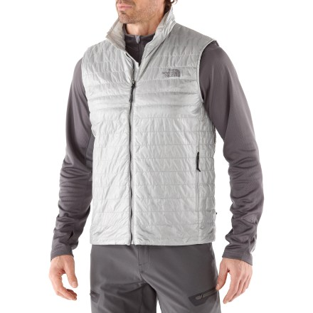 The North Face Blaze is a superlight, synthetic-insulated vest that packs down incredibly small for dependable warmth anywhere. FlashDry(TM) Thermal 60g synthetic insulation is extremely lightweight, warm and packable; plus, it retains warmth when damp and dries quickly. FlashDry microparticles are embedded in the insulation to dramatically improve dry time and breathability. Made of crushed coconut shells and crushed volcanic rock, the FlashDry additive leads to faster dry times and will not wash out. Longlasting center front, 3-color Vislon(TM) zip closure with interior windflap. Hem drawcord and elastic cuffs seal in warmth. Zip hand pockets. Extremely compressible, stash The North Face Blaze vest into its own pocket for easy carrying. - $90.93