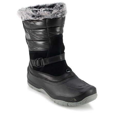 Camp and Hike The North Face Shellista Pull-On winter boots boast PrimaLoft(R) insulation, waterproof construction and a convenient slip-on design for winter versatility and style. Quilted shafts are made of recycled PET ripstop polyester mesh; full-grain and suede leather trim provides resilient performance with smart looks. Faux fur collars add a touch of style and help keep snow out of boots; instep strap supplies an adjustable fit. Seam-sealed waterproof construction ensures your feet stay dry. 200g PrimaLoft Eco insulation uses recycled materials to provide insulating warmth. Dual-density EVA midsoles in TNF Shellista Pull-On boots provide cushioning against shock. 3/4-length nylon shanks offer torsional stability for trekking on uneven ground. Waterproof thermoplastic rubber rand and outsole shells keep the slush at bay and feature forefoot flex grooves for comfort when walking. TNF Winter Grip(TM) rubber outsoles supply tenacious traction in wet, slick conditions; omnidirectional lugs are both grippy and self-cleaning. Temperature-sensitive Ice Pick(TM) rubber lugs on outsoles harden when temps fall below freezing, providing extra bite into the terrain. - $64.83