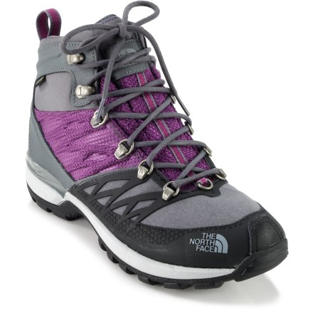 Camp and Hike The Iceflare Mid GTX winter boots by The North Face use strategic placement of PrimaLoft(R) insulation and Gore-Tex(R) waterproof membranes to supply wintertime comfort. Polyurethane-coated leather uppers help keep you light on your feet; rugged ballistic nylon mesh panels enhance flexibility, breathability and comfort. Neoprene collars enhance comfort and fit around ankles. Gore-Tex waterproof, breathable membranes ensure protection from the elements; polyester mesh linings wick moisture away from feet, helping keep them dry and comfortable. PrimaLoft Eco insulation uses a minimum of 50% recycled materials to ensure warmth and comfort during active use in conditions down to -10degF. 200g of insulation is placed in the forefoot and over the toes; 100g is used throughout rest of boot to help reduce weight and bulk. Forefoot, tongue and underfoot areas feature heat-trapping mylar inserts to help maximize heat retention. Removable Northotic(TM)+ dual-density footbeds feature soft heels and forefoot cushioning pads for maximum shock absorption. Dual-density EVA midsoles cushion feet for all-day wear, while embedded nylon forefoot plates create torsional rigidity and help support feet. Heel supports work to absorb impacts, stabilize feet and encourage an optimal stride for comfort and efficiency on the go. TNF Winter Grip(TM) rubber outsoles on the Iceflare Mid GTX winter boots grip snow and wet surfaces for solid traction. Temperature-sensitive Ice Pick(TM) rubber lugs on outsoles harden when temps fall below freezing, providing extra bite into the terrain. - $79.83