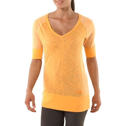Fitness The North Face Tadasana Hybrid Cover up keeps you comfortable to and from the yoga studio. Soft cotton fabric is breathable; polyester/cotton and polyester/elastane blend panels offer stretch. Wide rib-knit waistband keeps top in place. Deep V-neck for style. Closeout. - $28.73
